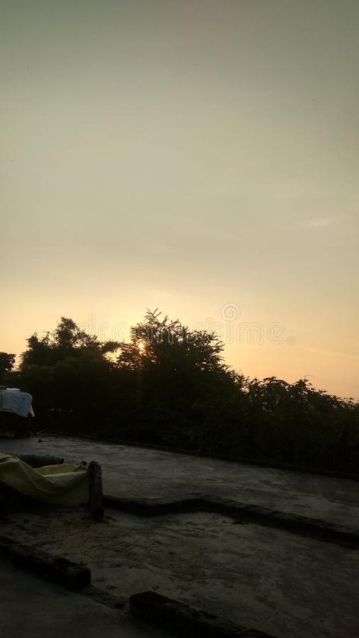 Sky image in evening time. Between two  trees and good nature of weather with environment stock images