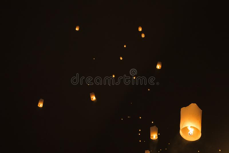 Sky lanterns glowing in night. Sky lanterns glowing against black night sky, Pai, Thailand stock photos