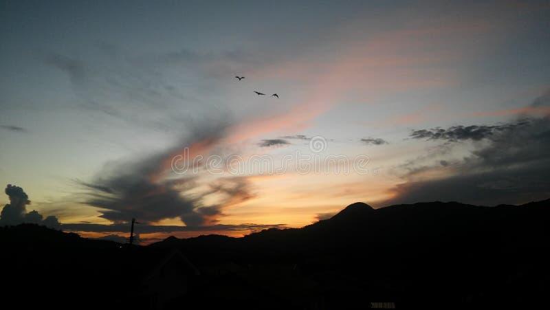 Sky mountain sunset sun birds royalty free stock photo