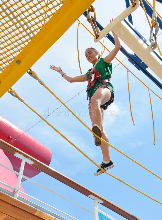 Sky Obstacle Course. On the Carnival Magic, Cruise ship. There is a obstacle course called the sky walk. You are harnessed in walk the course over 20 feet above royalty free stock photo