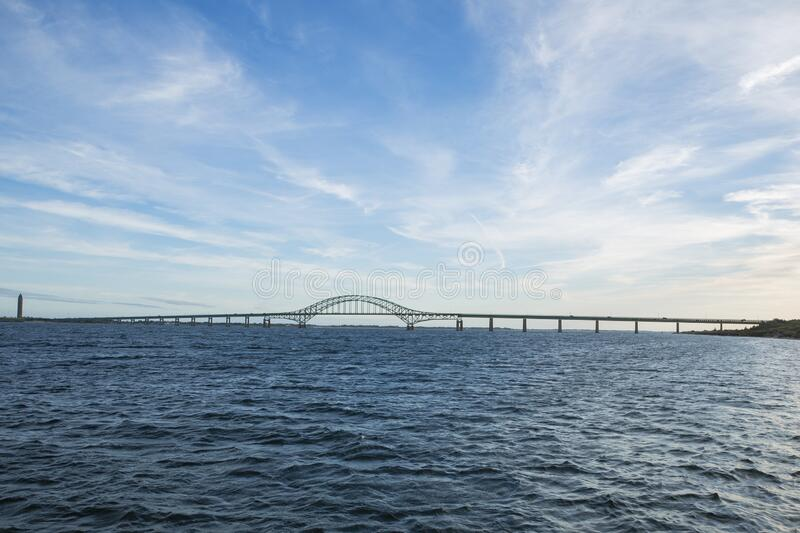 Sky, Ocean, Bridge and Distant Lighthouse royalty free stock image
