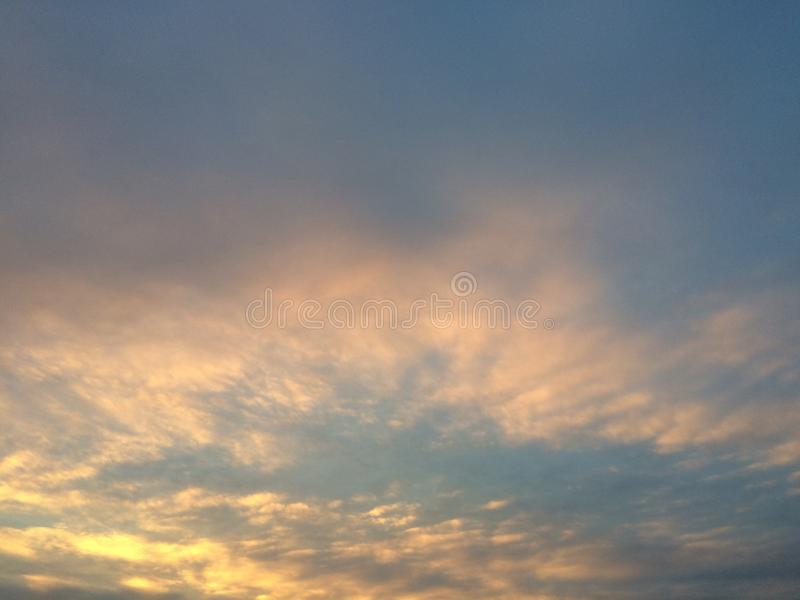 The Sky. A orange and blue sky as it nears sunset royalty free stock image