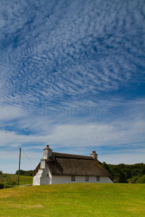 Sky over beautiful stone cottage stock images