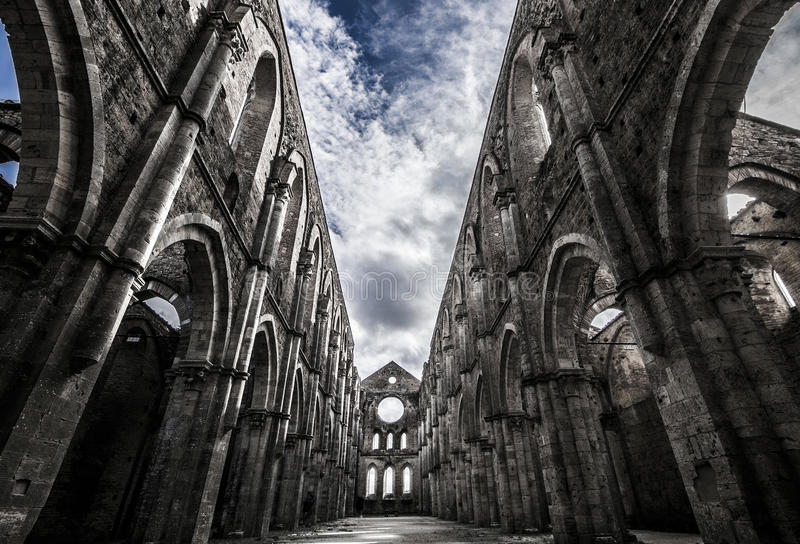 Sky over medieval san galgano abbey. On a cloudy day stock image