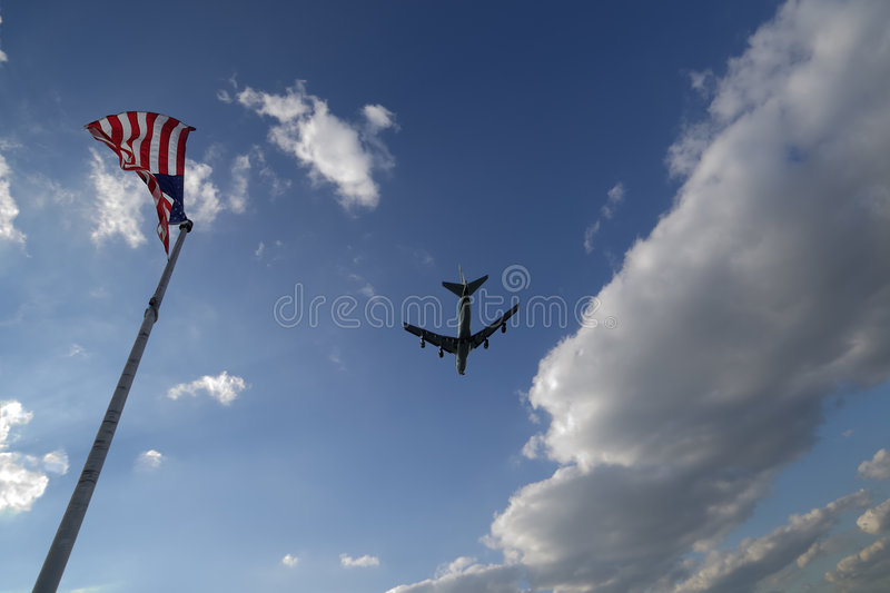Sky With Plane And Flags Stock Photography