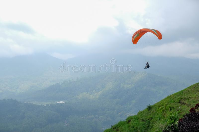 Paragliding in the sky of Batu, Indonesia. Sky racing by paragliding in Batu Malang, east java, Indonesia royalty free stock photography