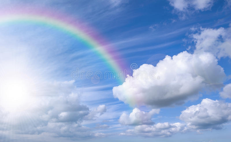 Sky with rainbow and bright sky stock photo