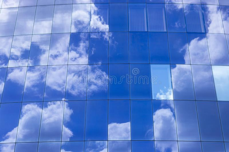 the sky reflected in glass stock image