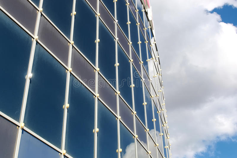 Sky reflected in office building. Background glass office building windows with reflection of sky in them stock image