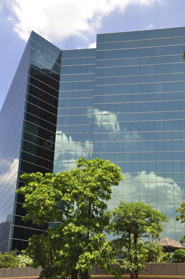 Sky reflection in glass tower stock photography