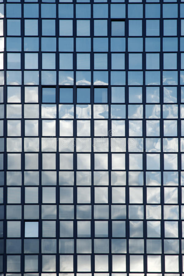 Sky Reflection In Windows Of An Office Building Stock