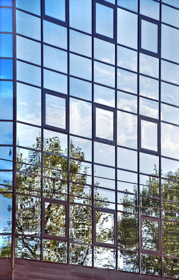 Sky reflections in the glass wall. royalty free stock photography