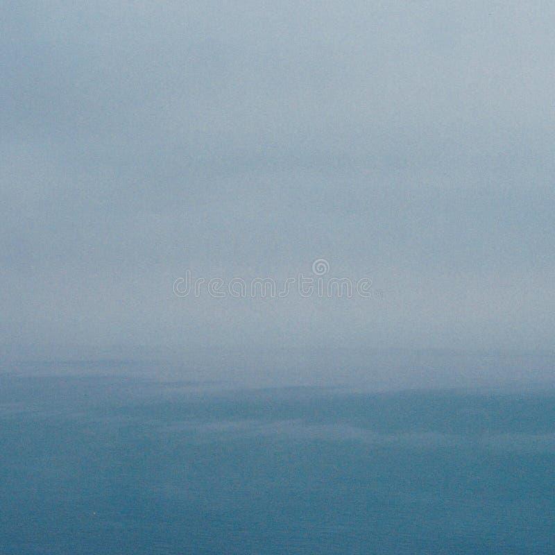 The sky runs into the sea royalty free stock photos