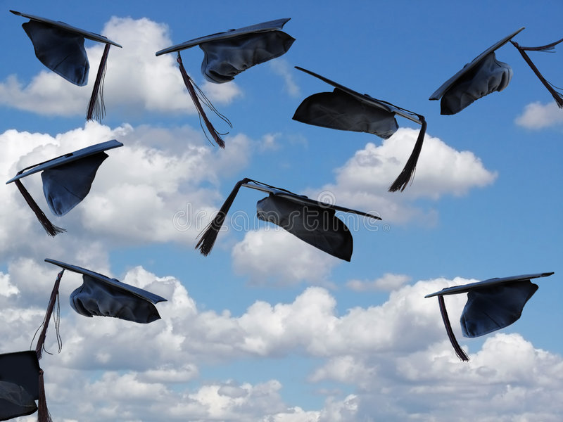 Sky's The Limit. Graduation caps being tossed into the sky royalty free stock photography