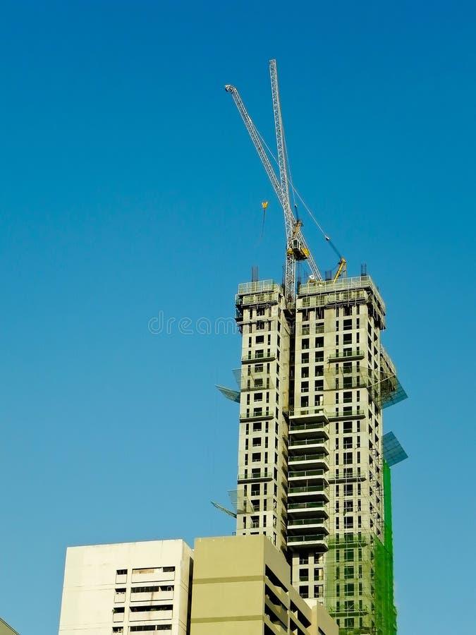 Sky Scraper Under Construction. A photograph of a tall sky scraper under construction stock photos
