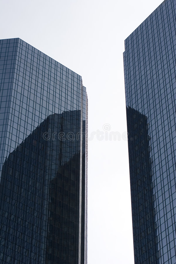 Sky scrapers. Sky-scrapers reflecting one another stock image