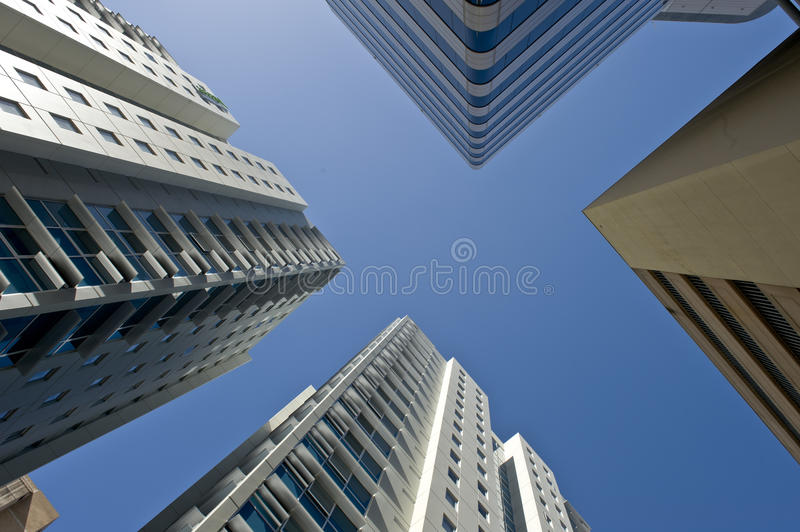 Sky Scrapers. Vierw of sky scrapers against the sky in a modern city royalty free stock photos