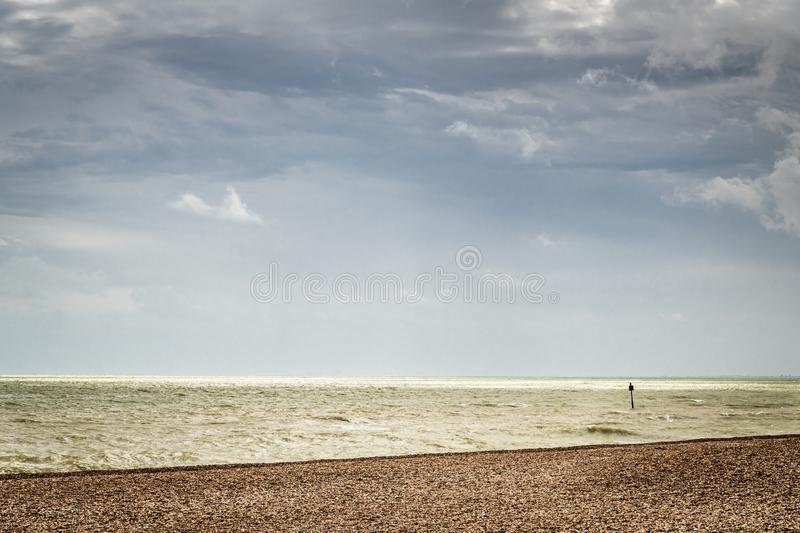 Sky, Sea and Beach. A tranquil image of the English Channel off the coast of England royalty free stock image