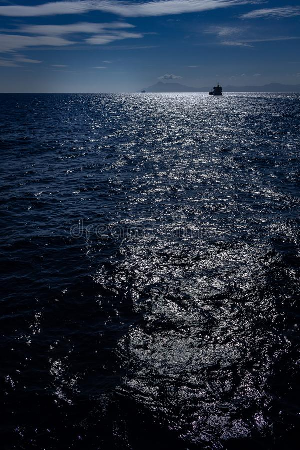 The sky and the sea dyed deep blue. The reflection of the sun on the water. stock photography