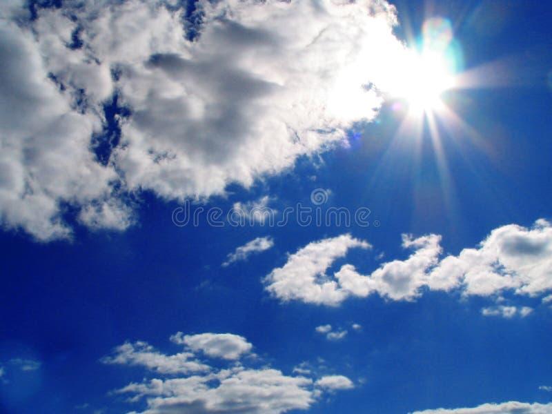 Sky-sun-clouds stock photo
