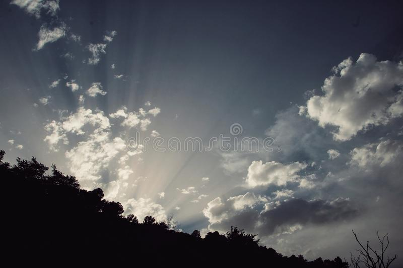 Sky with the sun rising. Sky with clouds and with the sun rising stock photo