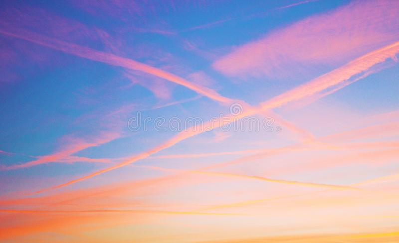 sky at sunset, the clouds are colored red by the sun that in a while will make room for the moon royalty free stock photos