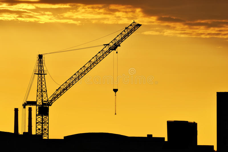 The sky at sunset. The end of the working day on the construction of a house in Saint-Petersburg on sunset background stock images