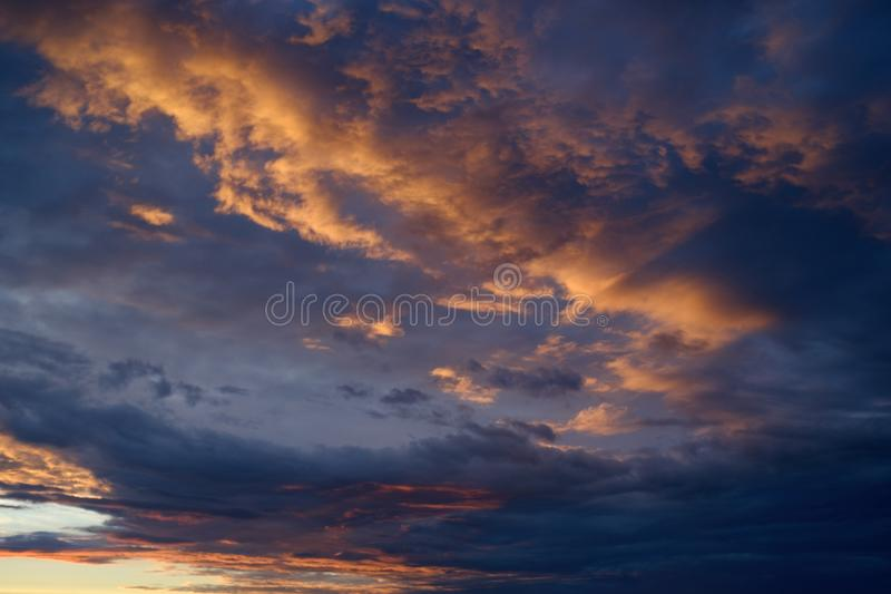 Sky sunset red clouds and dark cloudy clouds royalty free stock photography