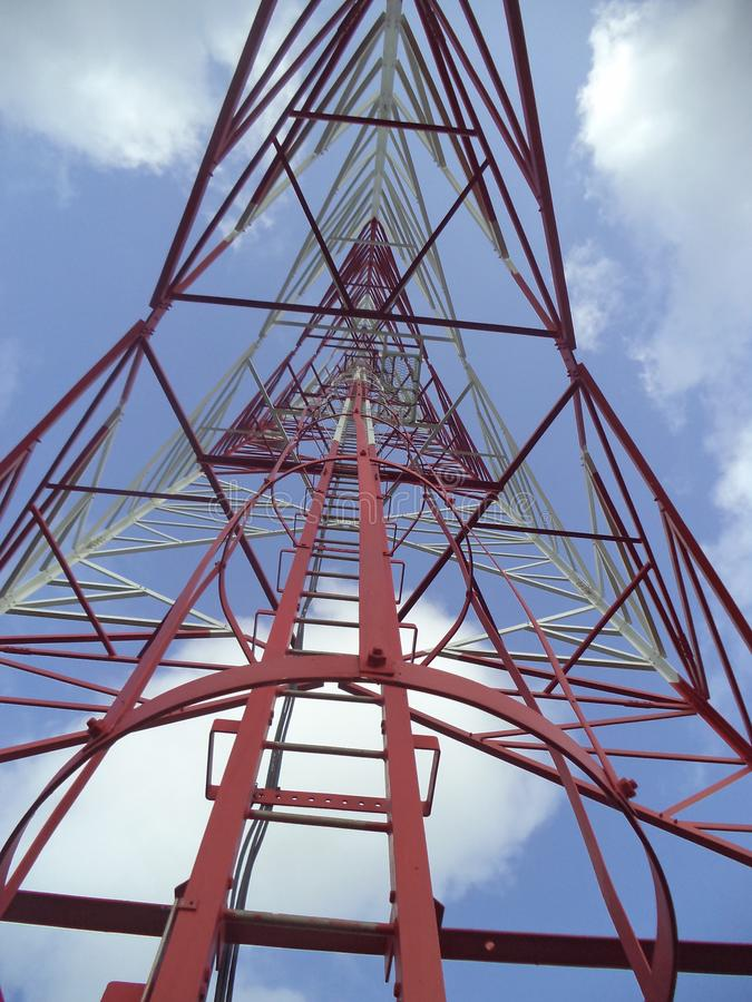 Sky through a telecommunication tower. This was taken from the bottom of a telecommunication tower. clouds are there. Location is Naugala in Sri Lanka stock photo