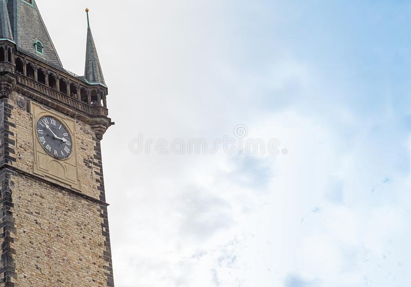 Sky tower gothic clock, historical building pointed roof close-up Prague Czech Republic 2017 royalty free stock image