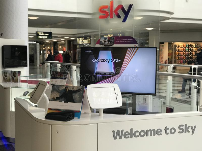Showcase of Sky in a shopping mall. Sky UK formerly British Sky Broadcasting Limited, BSkyB and Sky is a British telecommunications company which serves the royalty free stock photography