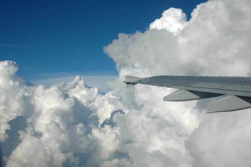 Sky view from an aircraft wind. Ow with stormy clouds stock photo