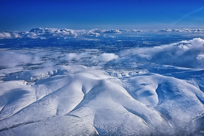 Sky view on a nord mountains. Big winter`s mountains from bird-eye stock photo