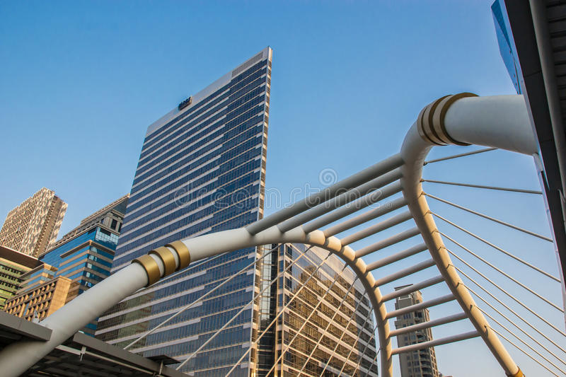 Sky walk view at bangkok skytrain station. Bangkok - March 16: View of railways, buildings and sky walk architecture to transit between Sky Train and Bus Rapid royalty free stock photography