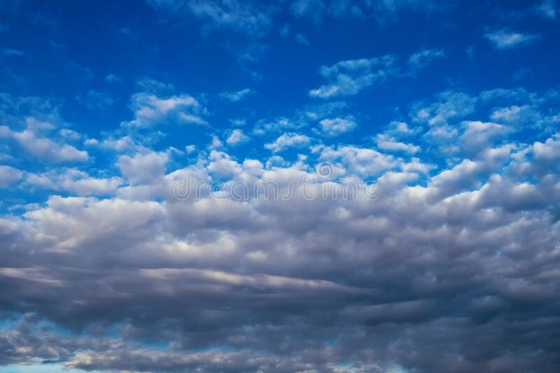 Sky with white clouds. Sky with white and dark clouds stock photos