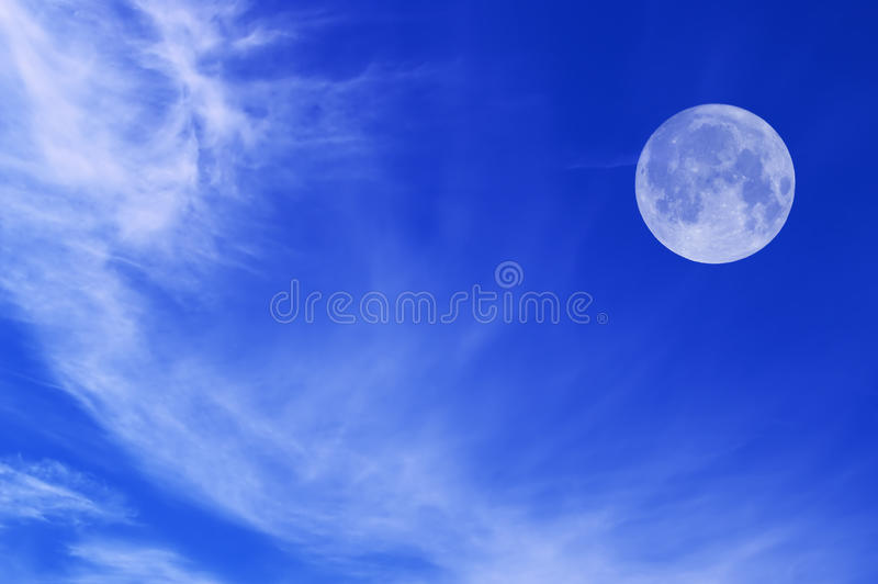 Sky with white clouds and moon royalty free stock photo