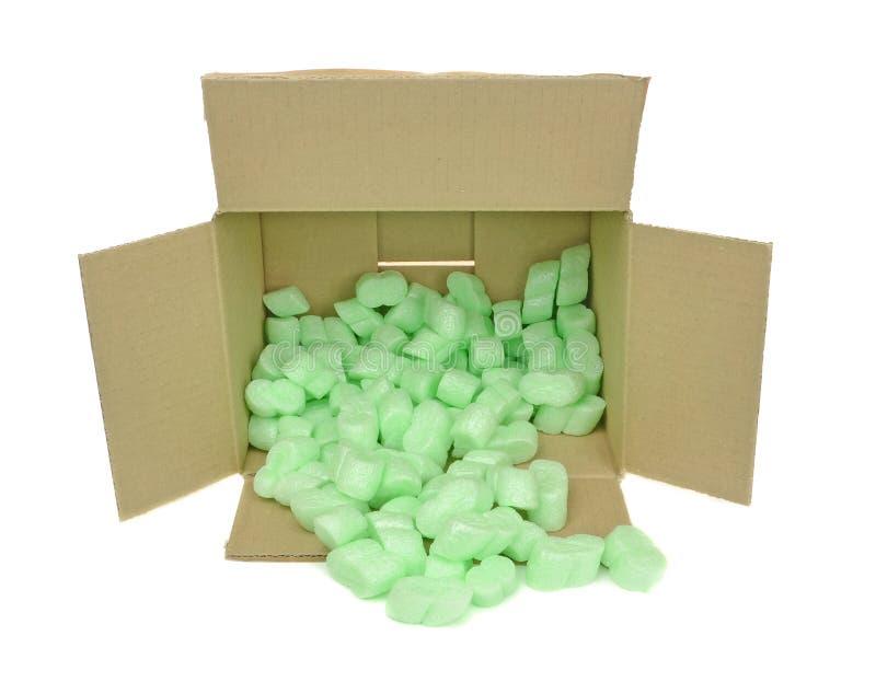Skyddande paketera skummar gå i flisor arkivfoto