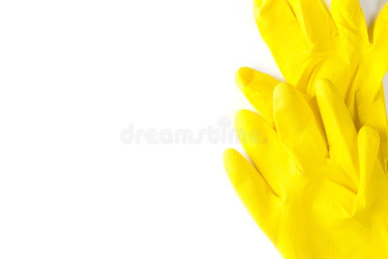 Skyddande rubber handskar som isoleras på vit bakgrund arkivfoto