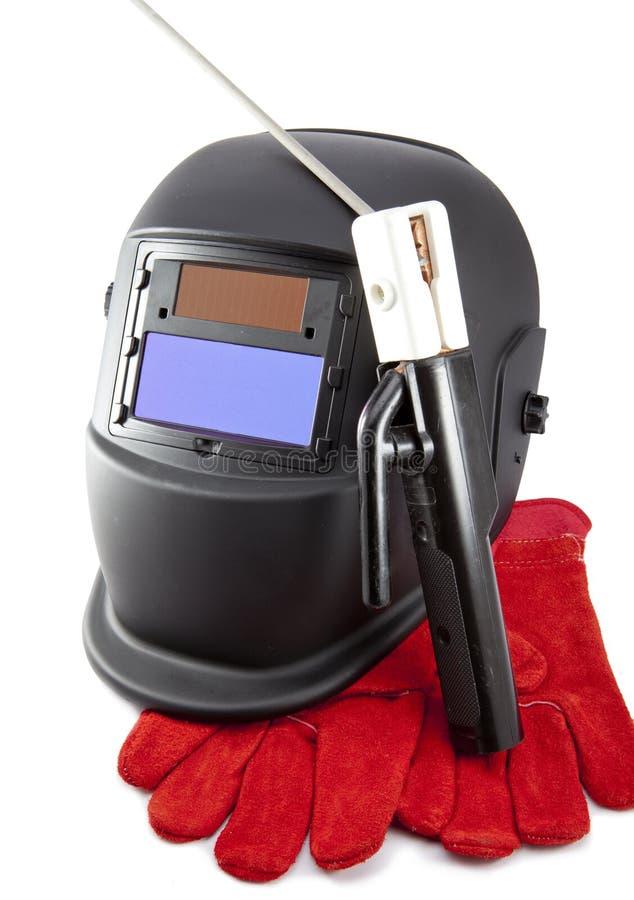 Skyddande weldermaskering, elektrod och handskar arkivbild
