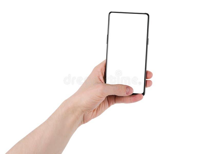 Skyddsram för hand för ung man hållande mindre smartphone som isoleras på vit royaltyfria foton