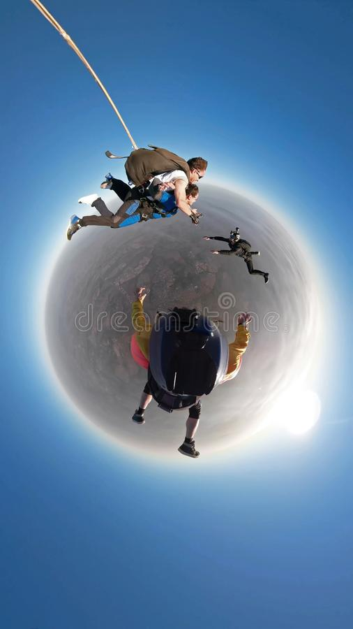 Skydiving tandem jump out of plane royalty free stock image