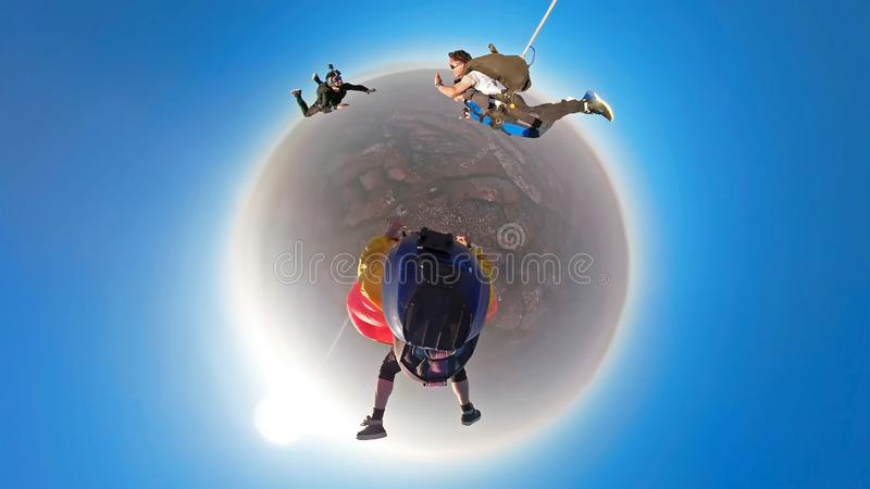 Skydiving tandem small planet stock photos