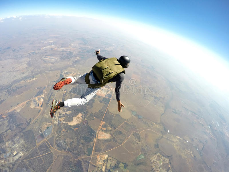 Skydiver in action. Skydiver flies through the air