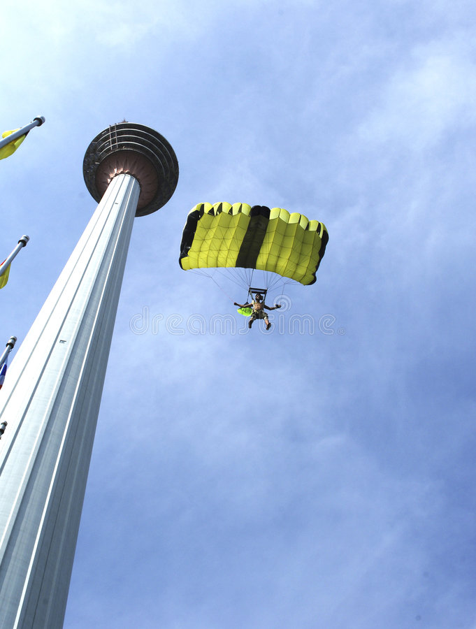 Skydiver jumping from KL tower stock photo