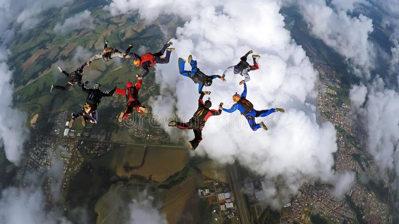Skydivers making two circles royalty free stock photos