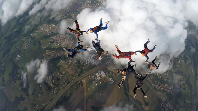 Skydivers making two circles royalty free stock image