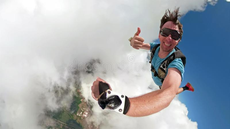 Skydiver selfie with a fish eye lens royalty free stock photography