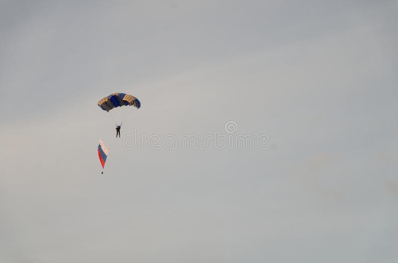 Skydiver under a dark blue little canopy stock image