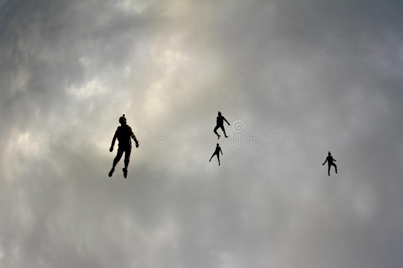 Skydiver are flying in the sky like a flock of birds. Skydivers are flying in the sky. They are look like a flock of birds in the sky royalty free stock images