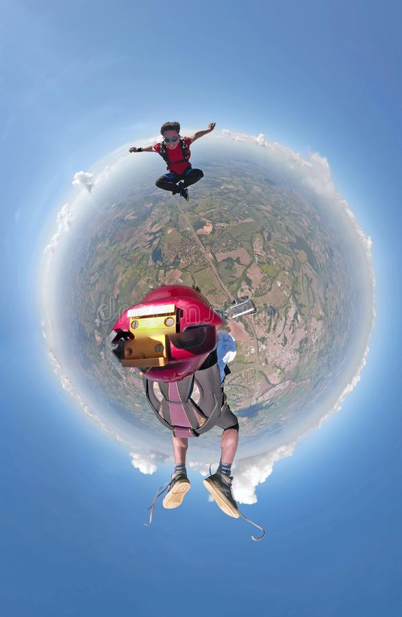 Skydivers having fun small planet view stock images